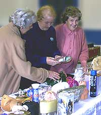 Jean, Marjorie and Eileen on the tombola